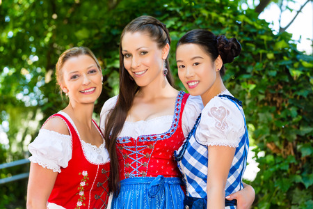 tracht: female friends in Tracht, and Dirndl in Bavaria, Germany