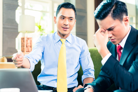worrying: Asian Businessman worrying while having a meeting