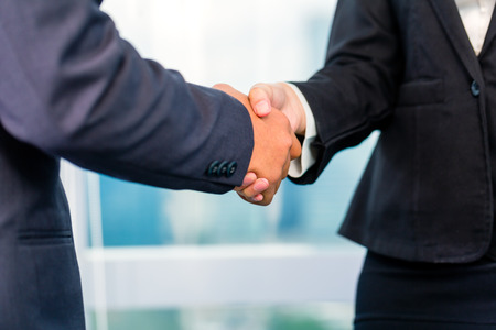 deal: Close up of business people shaking hands Stock Photo