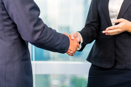 cooperating: Close up of business people shaking hands Stock Photo