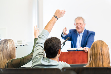 college professor: Students listening to college professor giving lecture