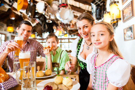 Bavarian family having traditional meal in German restaurant  photo
