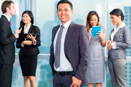 Portrait of Asian businessman with business team colleagues Stock Photo