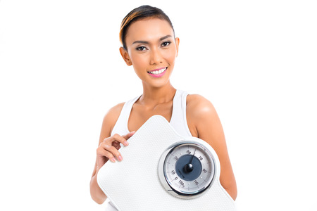 Young Asian woman losing weight by living healthy  photo