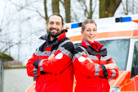 first help: Emergency doctor and nurse standing in front of ambulance car Stock Photo