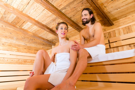 finnish: Couple relaxing together in wellness spa sauna with ice to cool down Stock Photo