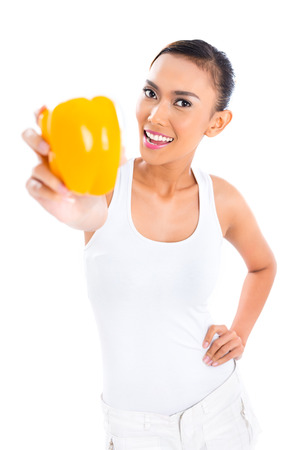 staying in shape: Young Asian woman living healthy and eating vegetables Stock Photo
