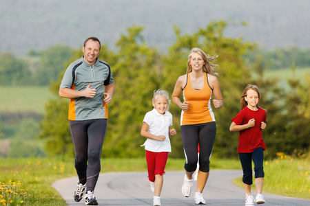girl fitness: Family jogging for sport for fitness outdoors with the kids Stock Photo