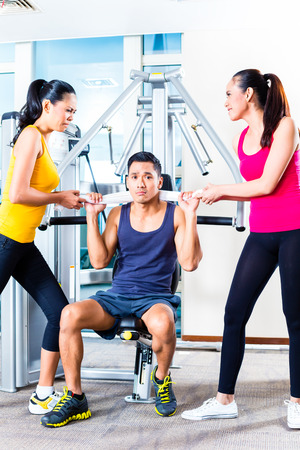 women fighting: Women fighting over man at gym
