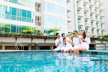 Asia Friends having fun by swimming pool