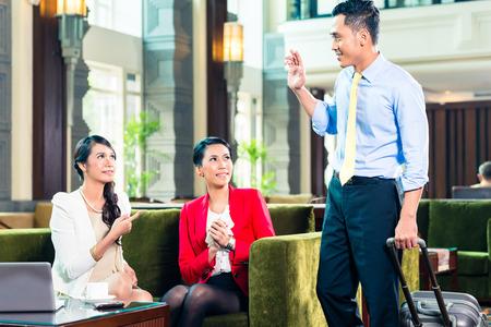 Asian businesspeople having meeting photo