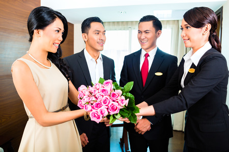 hotel staff: Staff greeting guests in hotel