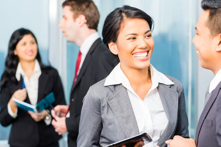 Portrait of Asian businesspeople talking Stock Photo - 28531143