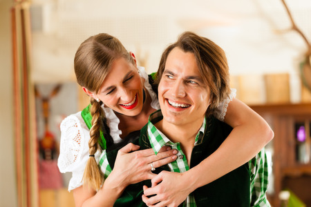 might: Young couple in traditional Bavarian Tracht in restaurant or pub, they might be the innkeepers