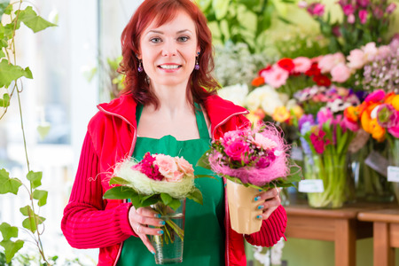 florist shop: Florist selling flowers and bouquets in shop