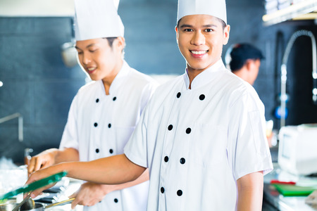 Portrait of young chefs cooking together photo