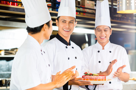 Portrait of young chefs wearing uniform photo