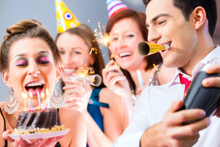 sexy birthday: Woman celebrating her birthday with friends in fancy cocktail bar