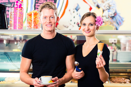 Ice-cream seller and waiter working in cafe selling ice cream wafer and coffee photo