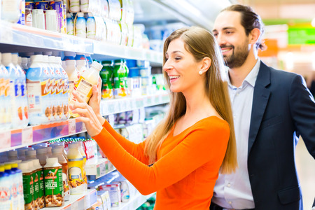 Woman selecting fruits while grocery shopping in supermarket  photo