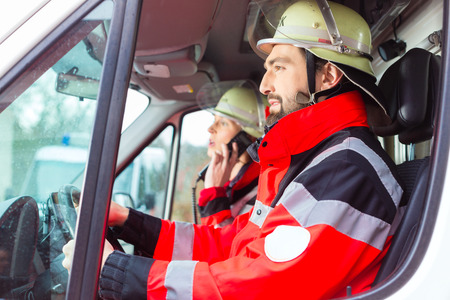 rescuing: Emergency doctor and nurse driving ambulance