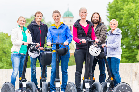 driven: Tourist group having guided Segway city tour in Germany