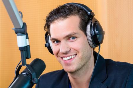 Presenter or host in radio station hosting show for radio live in Studio photo