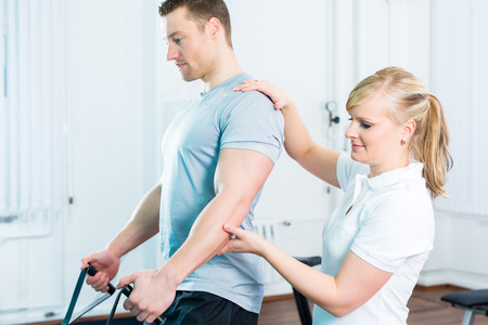 Patient at the physiotherapy doing physical exercises with Bowden cable  photo