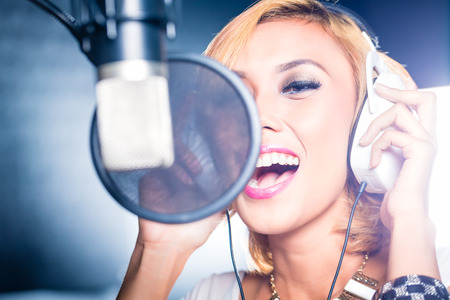 female singer: Asian professional musician recording new song or album CD in studio