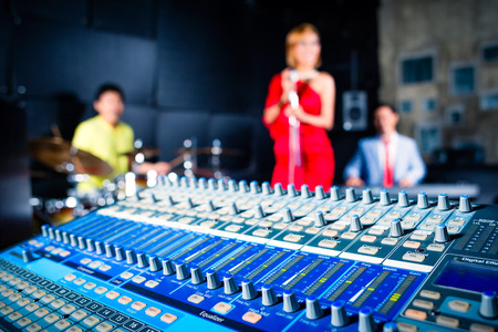 Asian professional recording studio mixing new song of band Stok Fotoğraf