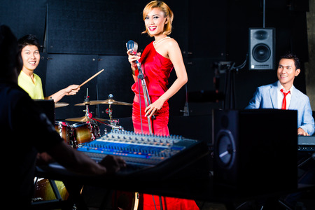 Asian professional recording studio mixing new song of band photo