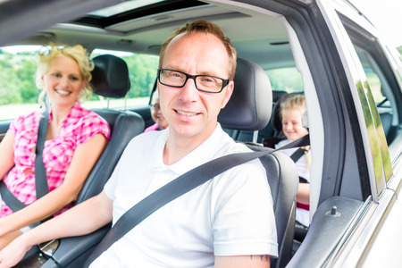 german girl: Family driving in car with seat belt fastened