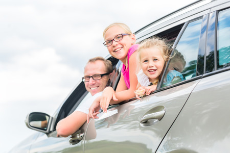 leaving: Family car - Father driving with daughters in auto