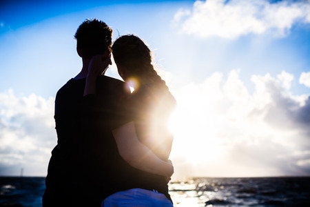 Couple enjoying romantic sunset at German north sea beach  photo