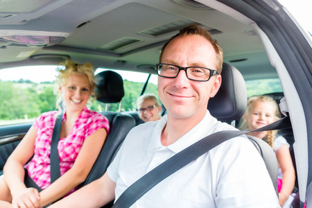 Family driving in car with seat belt fastened