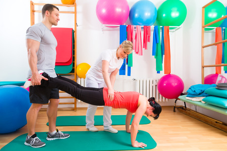 physical therapist: Patients at the physiotherapy doing physical exercises with therapist
