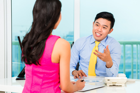 counsellor: Asian advisor with client on financial investment Stock Photo