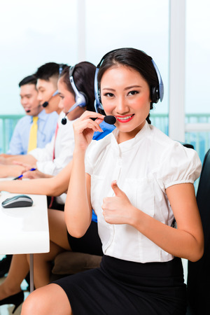 Asian Chinese call center agent team on phone photo