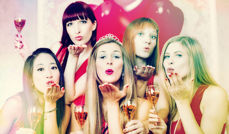 Bride and friends celebrating hen night with champagne in club photo