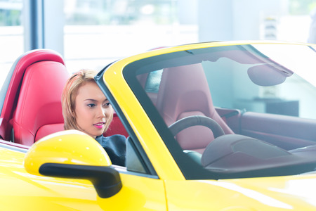 stetting: Asian woman testing new sports car