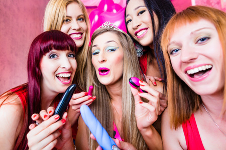 Women having bachelorette party with sex toys in night club