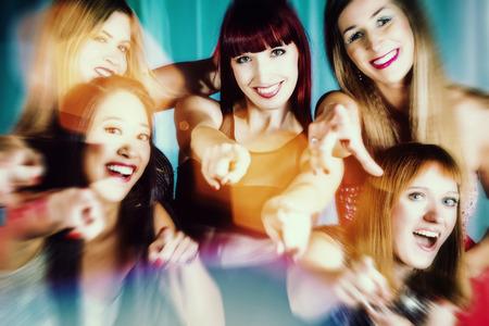 dancing club: Beautiful women dancing in discotheque or club Stock Photo