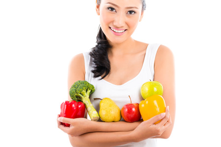 Asian woman eating healthy fruit photo