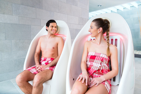 warming therapy: Couple infrared chair of wellness spa Stock Photo