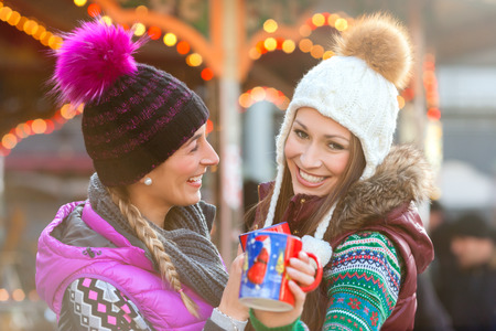 mulled: Friends drinking eggnog on Christmas Market