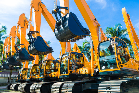 construction companies: Vehicle fleet with construction machinery of building or mining company Stock Photo