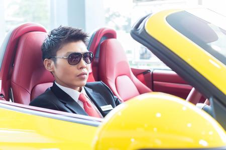 test drive: Asian man testing new sports car Stock Photo