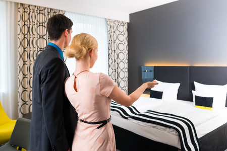 arriving: Man and woman arriving  in hotel room