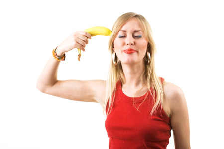 banana: Woman pointing a banana like a gun against her head