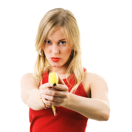 women with guns: Blond girl using a banana like a gun threatening the viewer